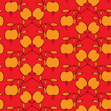 Seamless pattern with apples on a red background. Apples and leaves Royalty Free Stock Photo