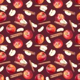 Seamless pattern with apples, slices and cinnamon sticks on maroon background. royalty free illustration