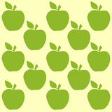 Seamless pattern with apples. On the yellow background Stock Photo