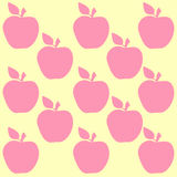 Seamless pattern with apples. On the yellow background Royalty Free Stock Images