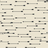 Seamless pattern with arrows. Cute simple background for printing on fabrics, paper, artwork, scrap-booking, surfaces. Vector illustration. Beige, light brown Stock Photo