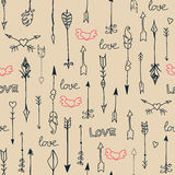 Seamless pattern with arrows and hearts. Painted hands Royalty Free Stock Photography