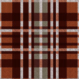 Seamless pattern as a knitted fabric in brown and grey colors Stock Images