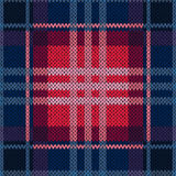 Seamless pattern as a knitted fabric in dark blue and red Royalty Free Stock Photo