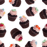 Seamless pattern of assorted mini cupcakes Royalty Free Stock Images