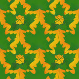 Seamless pattern in autumn colors made of maple leaves, green an Royalty Free Stock Image