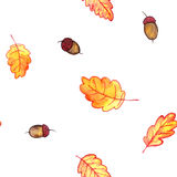 Seamless pattern with autumn leaves and acorns Stock Photos