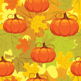 Seamless pattern of autumn leaves and pumpkins Royalty Free Stock Image