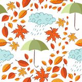 Seamless pattern with autumn leaves, umbrellas and clouds Stock Image