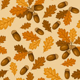 Seamless pattern with autumn oak leaves and acorns. Vector seamless pattern with autumn oak leaves and acorns on a beige background Stock Photo
