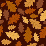 Seamless pattern with autumn oak leaves. Vector EP. Seamless pattern with autumn oak leaves of various colors on a brown background Stock Photo