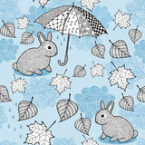 Seamless pattern with autumn wind, doodle umbrella and cute little rabbits. Vector endless background for babies or Royalty Free Stock Photography