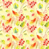 Seamless pattern of autumn yellow, red, orange, green leaves on a textured yellow orange background