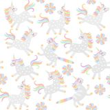 Seamless pattern for baby. Cute cartoon unicorns and caticorns and abstract flower isolated on white background in vector. Print for fabric, wallpaper stock illustration