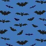 Seamless pattern background with bats. Unusual Halloween Vector illustration for your design. Royalty Free Stock Photo