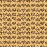 Seamless pattern background. Brown hearts on a gold ground. Fondness wallpaper.  Stock Images