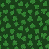 Seamless pattern background of green poker suits - hearts, clubs, spades and diamonds - on green background. Casino Royalty Free Stock Photo
