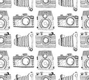 Seamless pattern background with hand drawn ornamental retro cameras. Stock Images