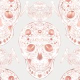 Seamless pattern, background with human skull in rose gold colors. Stock Image