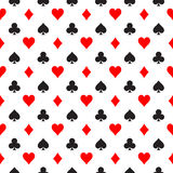 Seamless pattern background of poker suits - hearts, clubs, spades and diamonds - arranged in the rows on white. Background. Casino gambling theme vector Stock Images
