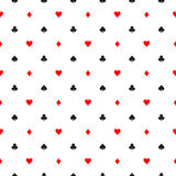 Seamless pattern background of poker suits - hearts, clubs, spades and diamonds - arranged in the rows on white Stock Photos