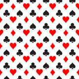 Seamless pattern background of poker suits - hearts, clubs, spades and diamonds - arranged in the rows on white. Background. Casino gambling theme vector Royalty Free Stock Photo
