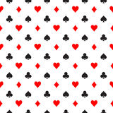 Seamless pattern background of poker suits - hearts, clubs, spades and diamonds - arranged in the rows on white Royalty Free Stock Photos