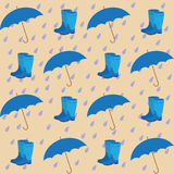 Seamless pattern on the background of the rain drops umbrellas. And rubber boots Royalty Free Stock Image