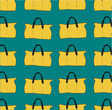 Seamless pattern of the bags. Yellow bags on a aquamarine Stock Photo