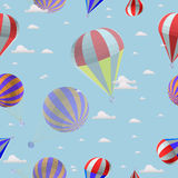 Seamless pattern of balloons against the blue sky with clouds Stock Photo