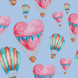 Seamless pattern of balloons in the shape of heart with baskets. Seamless pattern of balloons red and green in the shape of heart with baskets painted in Stock Photo