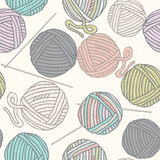 Seamless pattern with balls of yarn and knitting needles. Background in cartoon style. Royalty Free Stock Photos