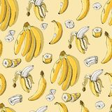 Seamless pattern with banana fruits on yellow background. Whole and sliced elements. Color hand drawn sketch vector illustration