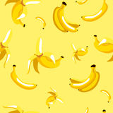 Seamless pattern of bananas on yellow background Stock Images