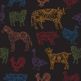 Seamless pattern based on farm animals decorated in ethnic style on black. Seamless pattern based on hand drawn farm animals decorated in ethnic style on black Stock Photography
