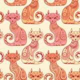 Seamless pattern with beautiful cats in the ethnic Royalty Free Stock Photo