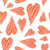 A seamless pattern of beautiful hearts painted in watercolor on Royalty Free Stock Image