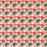 Seamless pattern of beautiful lovely graphic artistic abstract bright cute halloween orange, green pumpkins, red hot chili pepper Royalty Free Stock Image