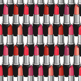 Seamless pattern with beauty lipsticks. Royalty Free Stock Photography