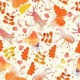 Seamless pattern with beetles, butterflies, grasshoppers and flowers in vintage style on yellow background Stock Photos