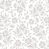 Seamless pattern with beige flowers on a white background. Vector illustration. Royalty Free Stock Image