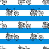 Seamless pattern, Bicycle hand drawn vector sketch, ink illustration old bike with floral basket on blue stripes Stock Images