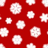 Seamless pattern of big blurry snowflakes. Christmas seamless pattern of big blurry snowflakes, white on red background Royalty Free Stock Photography