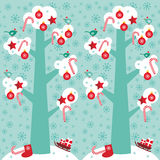 Seamless pattern Big tree with white snow on the. Branches, birds and red christmas decorations. Candy, balls, stars, sock, sleigh with gifts on sky-blue sky Stock Image