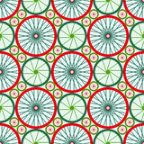Seamless pattern with bike wheels. Bicycle wheels with colored rims and spokes. Stock Image