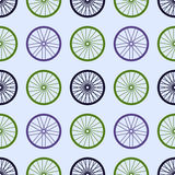 Seamless pattern with bike wheels. Bicycle wheels with colored rims and spokes. Stock Images