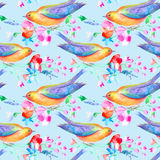 Seamless pattern of a bird and flowers. Poppy, bluebell, lavender, cornflower, berry, chamomile and daisy. Watercolor hand drawn illustration.Blue background Stock Illustration