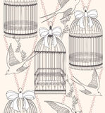 Seamless pattern with birdcages flowers and birds Stock Photos