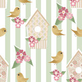 Seamless pattern with birdhouses and birds on striped Stock Images