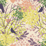seamless pattern with birds and blooming trees Stock Photography